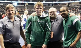 Rangely head wrestling coach Jeff Heinle and assistant coaches Gary Bennett and Blane Warrier stand next to senior Ethan Allred, the only Panther to qualify for the 2015 Colorado State Wrestling Championships. Allred won a match in the 2A, 170-pound bracket before being eliminated.