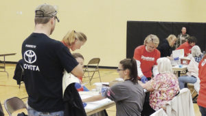 "Volunteers were helping en masse at the 9Health Fair at Meeker Elementary School on Saturday. Above, phlebotomists from all neighboring towns were on hand as were students from the CNCC dental hygiene school and health agencies from throughout the area joined efforts to deal with the roughly 600 people who attended the health fair on Saturday. The fair was sponsored by Channel 9, Pioneers Medical Center, the Rio Blanco Fire Protection District and the Meeker Lions Club. Organizer Christy Atwood of Pioneers Medical Center said, ""It was another successful year. I appreciate working with Channel 9 and appreciate all the members of the community taking part."""