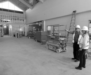 Visitors and patients who walk in will be greeted with a large lobby in the center of the front of the new Pioneers Medical Center. Another feature will be an enlarged clinic, which will feature 14 rooms compared to only nine rooms at the current facility, and there will be a number of expanded services. In the photo are Margie Joy, far right, and Drew Varland, right.