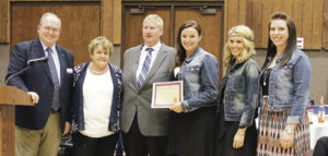Recognized for its constant willingness to help out when requested, the Western Rio Blanco Metropolitan Recreation District was honored at the annual CNCC Foundation Dinner on campus Saturday night. From left are: CNCC President Russell George, CNCC Foundation President Peggy Rector, dinner emcee and CNCC Board Member Sam Tolley and WRBM Recreation District representatives Kirstin Cushman, Camilla Kennedy and Bethany Green.