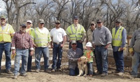 A crew from Williams Pipeline made major additions to the Rangely Community Gardens during its annual Day of Caring on March 31. From left to right are: Caleb Wiley, Lehi Smith, Deejay Chivers, Lori Lazarus, Steve Mahler, Rhet Tinker, Tyson Hacking, Kenny Fuller, Micky Kiever, Robert Baughman and Kevin Keel. Kneeling, from left, are: Joe Kerksieck, Otis Wiley and Zane Wiley.