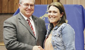 CNCC President Russell George congratulates Amy Griffin, the new president of the incoming PTK.