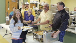After having the tests she wanted to take at the 9Health Fair on Saturday morning at Meeker Elementary School, Angie Arnold of Meeker, front left, enjoyed the breakfast offered by the Meeker Lions Club and its members to those who took part in the health fair. The Lions offered free pancakes, syrup, sausage, eggs, orange juice and coffee to those who participated in the fair.
