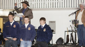 The highlight of the After Birth Ball was the auctioning of local FFA members with the high bidders getting a team of workers. Above is the Worker Lot No. 7, titled You Can't Roller Skate in a Buffalo Herd. Bryce Purkey, far right, was the auctioneer and the team of Chase Rule, Hunter Garcia, Sheridan Harvey and Casey Turner (not pictured) drew the highest bid of $660 from Shelton Ranch.