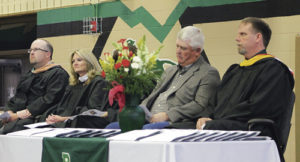 Honored guests on stage during Rangely High School's commencement exercise at  Rangely Junior/Senior High School Sunday afternoon were, from left: RHS Vice Principal and athletic director Crandal Mergelman, Principal Dr. K.D. Bryant, commencement speaker Alan Ducey of Ducey's Electric and Rangely School Superintendent Matt Scoggins.