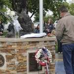 At 8 a.m. Monday, the public was invited to join the men and women from the Rangely Veterans of Foreign Wars Post at Hefley Park in downtown Rangely for the laying of a wreath at the Veterans Memorial. Other items such as flowers and an American flag were also laid at the foot of the statue. Despite light rain, approximately 35 members of the public came out to remember those who who gave of their lives in service to America as well as those still serving in the U.S. Armed Forces.