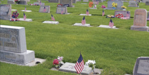 Throughout much of Highland Cemetery in Meeker on Monday, the number of Meeker residents who had served in the military is denoted by a small American flag placed on the graves of veterans. A strong percentage of those buried in Highland Cemetery have served in the Armed Forces, and many friends and family members were on hand at 10 a.m. at the cemetery to honor and recall those who gave up their lives in service to this country.