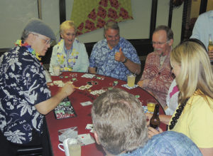From top left, Carol and Rich Parr of Meeker were two of those who were playing blackjack Saturday night at the annual Pioneers Healthcare Foundation Gala at the Fairfield Center in downtown Meeker. The two players at the bottom of the photo are Stan and Patty Wyatt, while the couple at the far right is unidentified and the dealer at the far left and all the other dealers were brought in from Denver. Blackjack, Texas hold'em and craps were available.