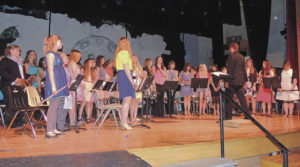 "Meeker High School/Barone Middle School music director Jeff Hemingson finished up Monday night's Meeker School District 2015 Spring Concert by directing all 78 members of the bands from sixth through 12th grades in ""Abandoned Treasure Hunt."""