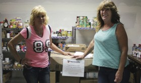 "On May 20, Leana Cox, right, of Colorado Northwestern Community College's Rangely Campus, the advisor for the campus Phi Theta Kappa chapter, organized a food drive. The efforts were ""not too shabby,"" Cox said. Chris Brasfield, left, who runs the Rangely Food Bank, was delighted. She said the food bank is in dire need of canned goods and that if PTK had not collected the food, she had no idea what the bank would have had available to hand out in the past week. Cox said she was glad for the effort and very proud of the way the students chipped in. PTK is the national honor society for two-year colleges in the United States."