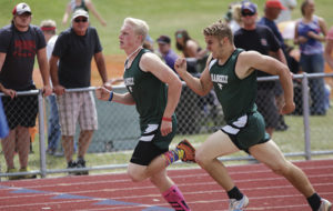 Rangely High School distance runner Patrick Scoggins (left) and Ethan Allred (right) are pressing hard to the finish line in the 800-meter run in Rangely on Saturday. The two finished third and fourth, respectively.