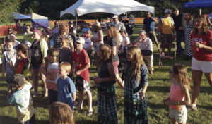 Hundreds of people gathered all around during Meekerpalooza 2014, held at Circle Park, across the White River from Meeker Town Park. This year, activities for the most part have been transferred to Ute Park, just west of Meeker.