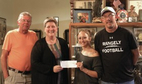 On June 10, Rangely Elks Lodge No. 1907 received a donation from the Chevron Corp. for $6,500. Lodge Exalted Ruler Jeff LeBleu said that $5,000 would go toward Christmas food baskets and that the other $1,500 would be donated to Rangely Community Gardens. Community Gardens is a group of local children, adults and farmers who get together and grow a full arrangement of vegetables for the folks of Rangely to enjoy. They also teach the children how to garden, which has turned into a positive influence on the participants. From left to right are Elks Bill Cady, Secretary Teresa Cady, Elk Rachel LeBleu and Exalted Ruler Jeff LeBleu.
