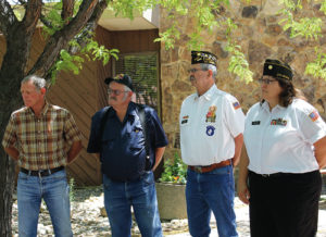 Members of the Rangely VFW Post gathered with residents and other officials to mark Flag Day and hold a ceremony in honor of the Stars and Stripes. Members of the Rangely post are, from left to right, Cork Powell, Joe Ingram, forer post commander Hoot Gibson and new post commander Lisa Hatch.