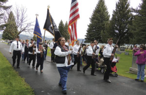"""Members of Veterans of Foreign Wars Post No. 5843, members of the Ladies VFW Auxiliary and members of the Meeker American Legion Post No. 74 marched in Highland Cemetery in Meeker to mark the beginning of the Memorial Day observance in Meeker. The ceremony was complete with laying a wreath on the memorial in the cemetery, a 21-gun salute and """"Taps."""""""