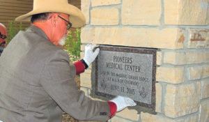 Meeker Mason Chuck Mills laid the cornerstone right outside the front door of Pioneers Medical Center on Saturday afternoon. Before he sealed the stone, a time capsule containing contemporary and a few past keepsakes were placed behind the stone. Many of those present said it was the first time in their lives they had seen a cornerstone laid.