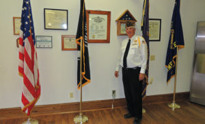 Dave Cole, the commander of Meeker Veterans of Foreign Wars Post No. 5843, stands with the flags that the VFW Color Guard marches with at official ceremonies. The VFW, VFW Ladies Auxiliary No. 5843, the Meeker Lions Club and American Legion Post No. 74 held on open house on June 9 at their new home at 290 Fourth St.