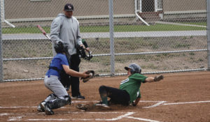 Austin Davis, who is safe at home as the Panthers defeated Craig on May 27 by a score of 8-2.