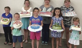 The winner of the Rio Blanco County Fair Cake Decorating Challenge is Natalie Knight, second from right in the front row. Knight was overall champion, having taken first place in Unit 1. Other winners were: Jessy Pelloni, who took second place in Unit 1; Cori Mohr, who took first place in Unit 2; Carys Walton, who took second place in Unit 2; Sierra Gomez, who took first place in Unit 4; Mary Baylie, who took first place in Unit 6; Jenna Pelloni, who took first place in pre-Cloverbud; and Holt Pelloni, who won first place in Cloverbud.