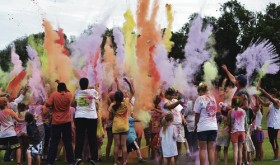 "Participants ran from the Rio Blanco County Courthouse lawn to the 6th Street Field, where they completed an obstacle course and got colored with dye. The end of the event, which was part of the ERBM Recreation and Park District's Meeker Appreciation Day, featured a ""color explosion,"" in which each participant threw a cup full of dye into the air to create the colorful display. More than 50 runners took part."