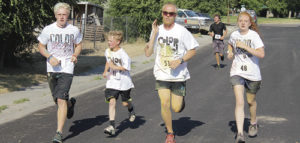 The winners of the Rangely Color Run, part of the Rangely Fourth of July activities, stuck pretty well together throughout the race. From left to right are: Patrick Scoggins, Andrew Dorris, William Scoggins and Savannah Nielson. Dorris won the race with a time of 23:18. Savannah Nielson won the women's category and finished tied for second overall as she and Patrick Scoggins each had a time of 23:39.