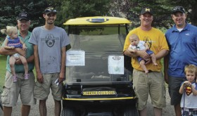 The defending champions of the annual Cowboy Kickoff Classic golf tournament all gave credit to the golf cart for their inspiration to defend their title. The champions were Jim Abshire (holding granddaughter Hadley), Matt Dupire, Andy Coryell (holding son Casey) and Eben Abshire (with son Westley).