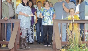 A ribbon cutting was held Thursday evening for the new Bear Mountain Inn Bed & Breakfast in Meeker; the site is the location of what was the Rambullinn at 789 8th St., formerly owned by Gus and Christine Halandras. Cheryl and Dale Houser are the new owners of the bed and breakfast, and they report good occupancy already during the hunting season. From left to right are: Gus Halandras, Danyel Harman of the Meeker Chamber of Commerce, Laura Cardile, Meeker Mayor Regas Halandras, Christine Halandras, Cheryl Houser, Cathy Caldwell, Toby Houser (Cheryl and Dale's son), Dale Houser, Allison Kobald and Meeker Chamber of Commerce Director Stephanie Kobald.
