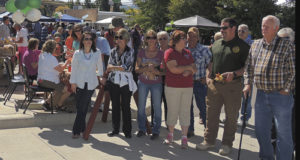 Folks at the annual Mountain Valley Bank's annual Fall Festival on Saturday wait anxiously for the annual cake/pie/salsa auction and the Ute Indian dancers from Fort Duchesne, Utah.