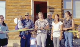 Many people joined owner Kari Brennan at the open house and ribbon cutting ceremony Aug. 3 for Meeker's newest business. White River Dental Hygiene, 73521 Highway 64, will be open for business sometime in September. Pictured at the ribbon cutting are, left to right: Danyel Harman (Meeker Chamber of Commerce), Neil Brennan holding son Milo Brennan, Hattie Brennan, Kari Brennan, Dr. Garry Millard (Kari's collaborating dentist from Rifle), Crystal Mecham from RDH (Kari's friend and fellow hygienist), Stephanie Kobald (Meeker Chamber of Commerce), and Carol Hamilton (Meeker Chamber of Commerce Ambassador).