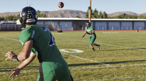 Rangely senior quarterback Kaulan Brady threw warmup passes prior to Friday night's game against Dove Creek.