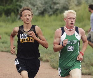Meeker High School's Austin Russell, left, and Rangely High School's Patrick Scoggins, right, run side by side during the weekend cross-country meet in Delta. Russell and Scoggins finished in 11th and 12th places, respectively.
