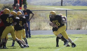 Barone Middle School seventh-grade quarterback Ryan Phelan gets some good blocking from his linemen against the Steamboat Springs Sailors. The young Cowboys have lost twice to the Sailors this season, but they beat Grand Valley. The eighth-grade team is still looking for its first win of the season. More than 37 kids went out for the team, which is coached by Darby Finley, Clinton Kilduff, Chip Brown and Jason Browning. The Cowboys will play in Craig on Saturday, then host Glenwood Springs the following week in the final game of the season.
