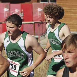Rangely High School sophomores Austin Ficken and Brennan Noyes charge up the hill at the Chris Severy Invitational.