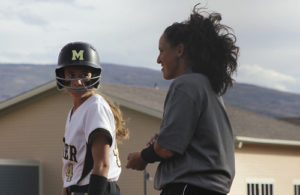 Meeker High School softball coach Briana Williams smiles after Gracie Bradfield got a base hit during a game against Basalt. Meeker's record is 9-6 overall, 4-2 in league and currently on a three-game winning streak after pounding Aspen twice in a doubleheader and Basalt, all at Paintbrush Park. Meeker will play in Rifle today and Gunnison on Saturday before the regional tournament starts the following week.