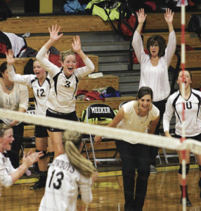 Members of the MHS volleyball team cheer after a win. The team has had difficulty gaining momentum this season, but hopes to turn things around this weekend against Paonia.