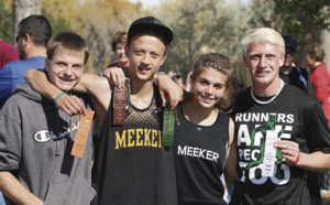 Four cross country distance runners from Rio Blanco County qualified on Saturday to compete in this weekend's Colorado State Cross Country Meet on Saturday in Colorado Springs. From left to right are Meeker Cowboy distance runners Marshall Pool, Austin Russell, Julia Eskelson and Rangely Panther Patrick Scoggins, who took third overall.