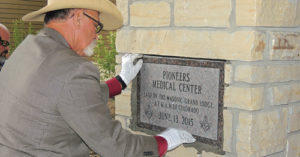 Meeker Mason Chuck Mills laid the cornerstone right outside the front door of Pioneers Medical Center on June 13, 2015. Before he sealed the stone, a time capsule containing contemporary and a few past keepsakes were placed behind the stone. Many persons present said it was the first time in their lives they had seen a cornerstone laid.
