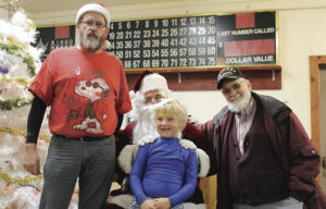 It was a family gathering this past weekend in Rangely as the Rangely Elks Lodge held its annual Christmas party. Some of those present were four generations of the Hall family. In the back row, from left, are: Norm Hall Jr., Chris Hall and Norm Hall Sr. In the front row is grandson Chubby Hall.