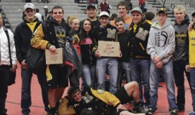 "The Meeker Cowboys won 36 matches in the 2015 Warrior Classic, 24 by pin, which earned bonus points, enough for Meeker to be the ""Best Small School"" team and fifth overall. Meeker's three-time state champion T.J. Shelton won his first individual Warrior title and was named ""Outstanding Wrestler"" in the upper weights. Head coach J.C. Watt said he was ""really proud of all the kids"" and the Warrior Classic was a ""good confidence builder"" for his team. Pictured are assistant coach Carl Padilla, head coach J.C. Watt, Chase Rule, T.J. Shelton, team managers Abbey Morgan and Avery Watt, Tyler Ilgen, Sheridan Harvey (holding trophy), Jacob Pelloni, Caleb Bradford, Hunter Garcia, Tannen Kennedy, Casey Turner, Garrett Frantz and assistant coach Tyrell Turner. Devon Pontine is in front."