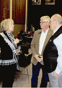 Joyce Rankin, left, a member of the Colorado Board of Education, and Bob Rankin, center, a member of the Colorado House of Representatives, speak with former legislator Russell George, now president of Colorado Northwestern Community College, at the Rangely Chamber of Commerce's annual Crab Crack and award dinner on Saturday.