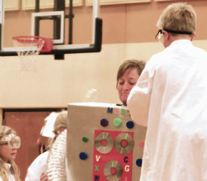School Principal Kathy Collins said she would dress up like a robot if there were 1,750 books checked out during the month, and when it was all done, 1,787 books had been checked out and Collins donned a robot costume.