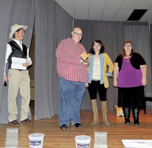 From left to right are: Crab Crack Master of Ceremonies Jed Moore, Pastor Shannon Brumfield, Chamber Executive Director Kristin Steele and Krystal Brumfield.