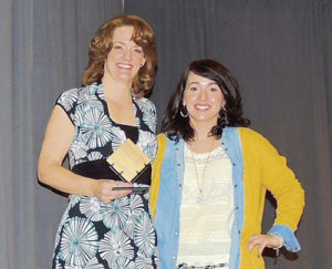 Naomi Legere, left, with the Non-Profit Business of the Year Award for the Rangely Museum, presented by Kristin Steele.