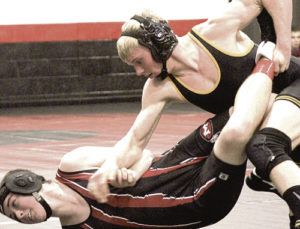 Meeker junior Casey Turner uses an ankle pick to takedown one of his opponents in the Screamin' Eagle Wrestling Tournament in Paonia in January. Turner won the 152-pound bracket and helped his team to a second place finish at the large multi-school tournament.