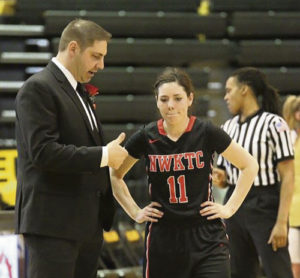 Meeker High School graduate Kaysyn Chintala, is seen here talking with her Northwest Kansas Technical College coach, Landon Steele, during the most recent season, where Chintala set school records in three-point shots and assists. Chintala, who started college playing volleyball, will now continue her education and play on the basketball court at an undecided four-year school.