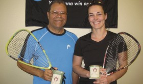 "Bob Sanders, left, of Payton, Colo., and Rangely resident Andrea Gianinetti, right, get a ""mug shot"" taken of the second-place trophies they won in the C/D doubles division of the 23rd Rangely Racquetball Tournament, held March 4-6. One-third of this year's 29 tournament participants were local, and several of them were mothers brought into the sport by Gianinetti, who began learning from resident expert Shirley Parsons three years ago."