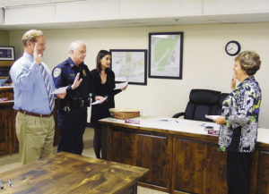 From left, Meeker Town Administrator Scott Meszaros, Meeker Police Chief Bob Hervey and Town Attorney Melody Massih were sworn into office by Meeker Town Clerk Lisa Cook at Tuesday evening's Meeker Town Council meeting. The appointments of these town officers must be formally made and the individuals must take the oath of office along with the seating of new and re-elected town council members.