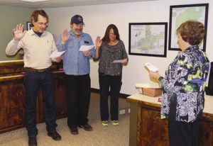 From left, newly re-elected Meeker Mayor Regas Halandras, re-elected Town Council member Travis Day and new town Council member Melissa Kindall took their oaths of office at the Meeker Town Council meeting on Tuesday evening, sworn into office by Meeker Town Clerk Lisa Cook. Halandras and Day are beginning their second terms in office. Newly elected Town Council member Wendy Gutierrez, who was not available to be sworn in as she was attending economic development training on the Front Range, along  with a few other Meeker business people, will be sworn into office May 3.
