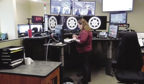 One of seven Rio Blanco County dispatchers, Rhawnie McGruder is seen here running the central desk, computers and display screens where 911 calls are first answered at the new Rio Blanco County Justice Center.