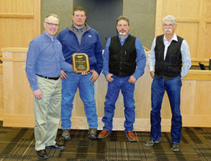 Jeff Kirtland, left, of WPX Energy presented a plaque of appreciation to Rio Blanco County Commissions, second from left to right, Jeff Eskelson, Shawn Bolton and Jon Hill on Tuesday morning for the cooperation between the company and the county over the past couple of years, which, Kirtland said, has meant much to the advancement of WPX Energy and the county.